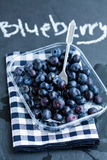 Fresh blueberries and fork Stock Photography