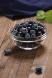 Fresh blueberries in a glass bowl Stock Image