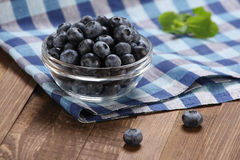 Fresh blueberries in a glass bowl Royalty Free Stock Photos