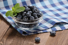 Fresh blueberries in a glass bowl on t Stock Photography
