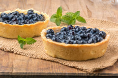 Fresh blueberries homemade tart on a wooden desk Royalty Free Stock Photo