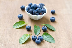 Fresh blueberries with mint leaves. Royalty Free Stock Images