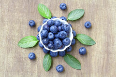 Fresh blueberries with mint leaves. Royalty Free Stock Photo
