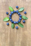 Fresh blueberries with mint leaves. Stock Photos