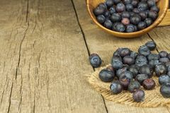 Fresh blueberries on old wooden table. Homework marmalade. Healthy forest fruit. Nutrition for athletes. Stock Image