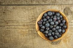 Fresh blueberries on old wooden table. Homework marmalade. Healthy forest fruit. Nutrition for athletes. Royalty Free Stock Photo