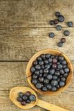 Fresh blueberries on old wooden table. Homework marmalade. Healthy forest fruit. Nutrition for athletes. Royalty Free Stock Photography