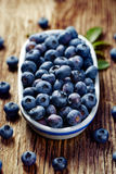 Fresh blueberries in an oval ceramic pot on a wooden table Stock Image
