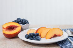 Fresh blueberries and peaches Royalty Free Stock Images