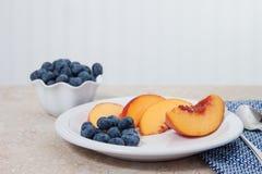 Fresh blueberries and peaches Stock Photos