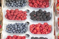 Fresh blueberries, raspberries and blackberries on a market in Italy Royalty Free Stock Image