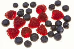Fresh blueberries, raspberries, closeup on white background. Background for confectionery, cafe fresh berries for pastry. Fresh blueberries, raspberries Stock Photography