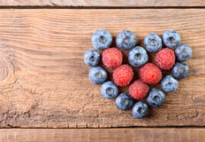 Fresh blueberries and raspberries Royalty Free Stock Photography