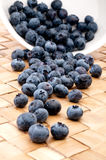 Fresh blueberries spilling from a bowl Royalty Free Stock Images