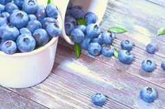 Fresh blueberries. Sprinkled on a wooden background Stock Photography