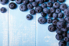 Fresh blueberries. On thw blue colored wooden table Royalty Free Stock Photos