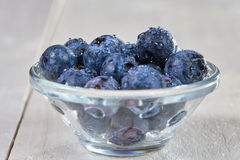 Fresh blueberries with water drops in a glass bowl Stock Photo