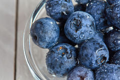 Fresh blueberries with water drops in a glass bowl Royalty Free Stock Photos