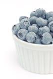 Fresh blueberries in white bowl Stock Images