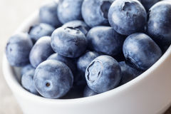 Fresh blueberries in white bowl Stock Photo
