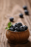 Fresh blueberries in a wooden bowl Stock Images