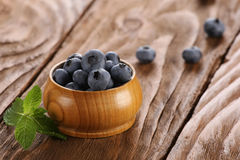 Fresh blueberries in a wooden bowl Stock Photo