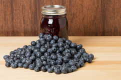 Fresh blueberries on wooden table with jam Stock Image
