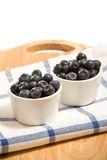 Fresh blueberry. In two white dishes royalty free stock photo