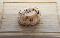 Fresh Blueberry Bagel on Wood Cutting Board Stock Image