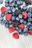 Fresh blueberry, blackberry and raspberry. On wooden table Royalty Free Stock Photography