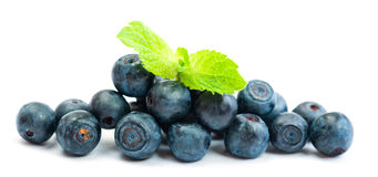 Fresh blueberry with green leaves of mint. On white background Stock Image