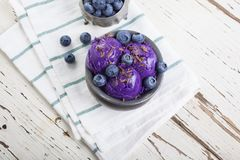 Blueberry ice cream on pewter cup Stock Photos