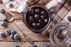 Fresh blueberry marmalade in a glass jar close up. horizontal to Stock Photos