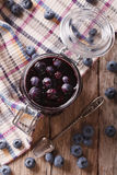 Fresh blueberry marmalade in a glass jar close up. Vertical top Royalty Free Stock Image