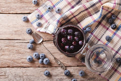Fresh blueberry marmalade in a glass jar. horizontal top view Stock Photo