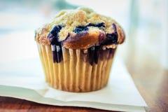 Fresh blueberry muffin on napkin stock image