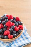 Fresh blueberry and rasberry. On wood bowl Royalty Free Stock Image