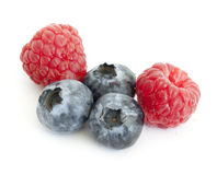Fresh blueberry and raspberry. On the white background Stock Photos