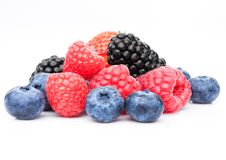 Fresh blueberry raspberry and blackberry. Closeup on white background Stock Images