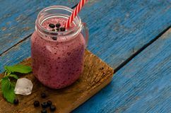 Fresh Blueberry smoothies on blue wooden boards