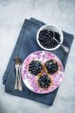 Fresh blueberry tart on vibrant plate Stock Images