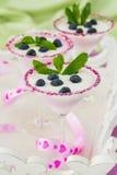Fresh blueberry yogurt dessert in martini glasses Royalty Free Stock Photography