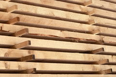 Fresh boards. Boards in warehouse. Sawmill. Stack. Background Royalty Free Stock Photo