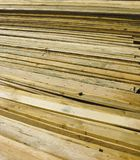 Fresh boards. Boards in warehouse. Sawmill. Stack. Background stock image