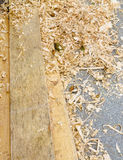 Fresh boards and wood shavings Royalty Free Stock Photos