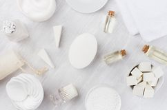 Fresh body and skin care spa cosmetics collection and natural bath accessories on white wood background, top view. Fresh body and skin care spa cosmetics stock images