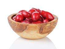 Fresh bogwood berries in wood bowl isolated on Royalty Free Stock Image