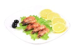 Fresh boiled shrimps with lemon. Stock Images