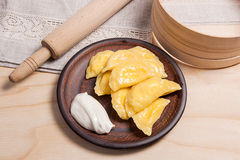 Fresh boiled varenyky or dumpling with cottage cheese or curd on Royalty Free Stock Images
