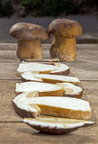 Fresh Boletus Edilus mushrooms on a wooden table Stock Images